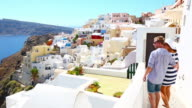 HD: Happy young couple on Santorini island, Greece