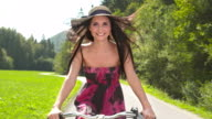 HD: Happy Young Woman Riding Bicycle