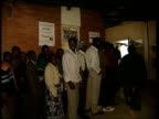 Harare EXT AT NIGHT People waiting to vote TRACK People queuing to enter polling station DAY Queue of people waiting to vote snaking away Ditto PAN...
