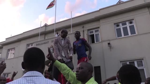 Harare residents take to the streets in celebration after Robert Mugabe resigns as leader of Zimbabwe