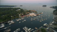 AERIAL, Harbor and town at sunset, Camden, Maine, USA