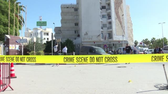 A hardline Islamist stabbed two Tunisian policemen on Wednesday in front of parliament gravely wounding one of them the interior ministry said