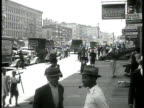 Harlem VS AfricanAmerican Black people walking on sidewalk crossing street children on sidewalk vendor w/ 'Peace shine 3 cents' children in waiting...