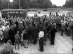 Harold Macmillan tours Stevenage and Harlow New Town ENGLAND Stevenage MS Harold Macmillan walks along with officials through camera factory CMS...