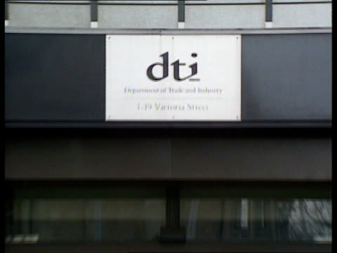 DTI takeover report verdict ITN ENGLAND London DTI AV Department name sign ZOOM OUT GV People leaving DTI building