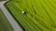 AERIAL Harvesting Rapeseed Field Flyover Shot