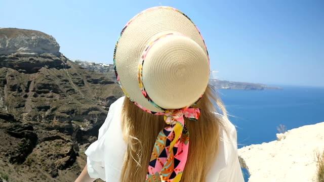Hat falling down & beauty in Santorini