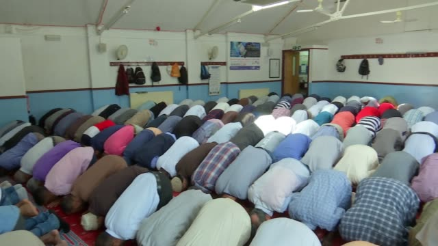 Hate crimes targeting mosques more than double in a year T23061705 / TX 2362017 Muslim Welfare Centre INT Muslim men kneeling down praying inside...