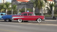 Havana, Cuba: old vintage cars in 'Malecon Avenue' plus the everyday lifestyles and transportation in the tourist area