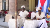 Havana, Cuba: 'Santeria' as a tourist attraction, ladies telling future in the Cathedral Square or plaza