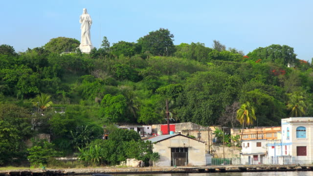 Havana, Cuba: Zoom out from 'The Christ of Havana' which is a white Carrara marble sculpture in the capital city of the Caribbean Island