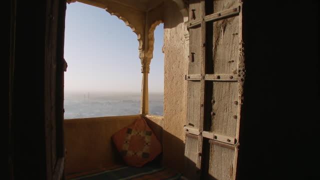 MS Haveli window with overlooking town / Jaislamer, Rajasthan, India