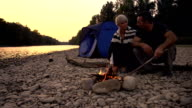 HD DOLLY: Having A Campfire At Sunset