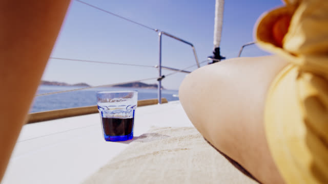 MS Having a drink on a deck of a sailing sailboat