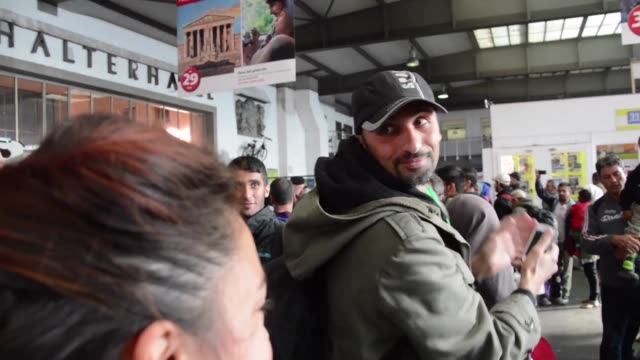 Having braved dangerous journeys to escape war tired refugees from Syria and other conflict zones were stunned to receive a hero's welcome as they...