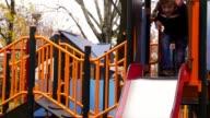 Having fun on playground slide