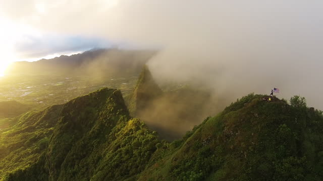 Hawaii aerial pan, Mt Olomana with people.