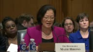 Hawaii Senator Mazie Hirono reads prepared remarks at a hearing of the Senate Finance Committee on a health care block grant bill cosponsored by...