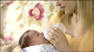 Hayley Wilde feeding baby with bottle