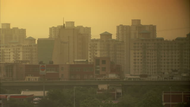 Haze obscures high rise buildings in Delhi, India.
