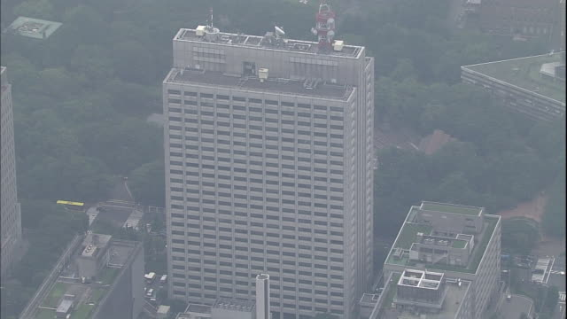 Haze settles over the Ministry of Health, Labor and Welfare, the Joint Government Building and Hibiya Park in Tokyo.