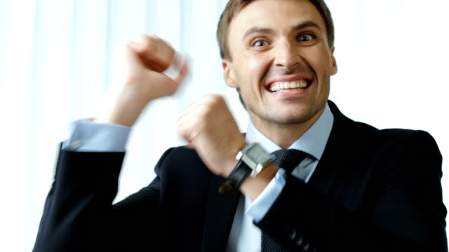HD1080p: Happy successful gesturing smiling young businessman, looking at camera