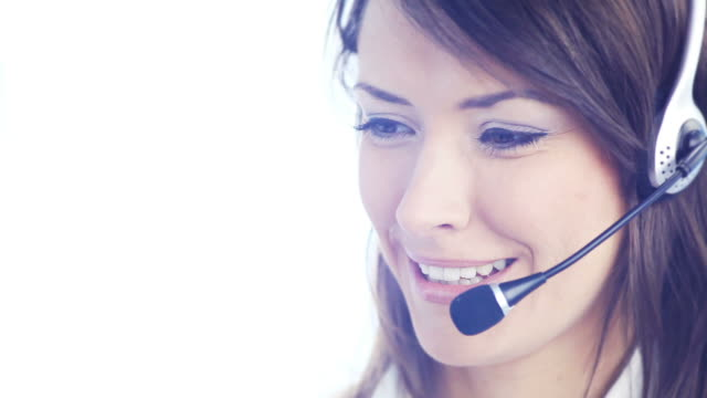 HD1080p30: Customer support phone operator smiling, speaking, looking at camera