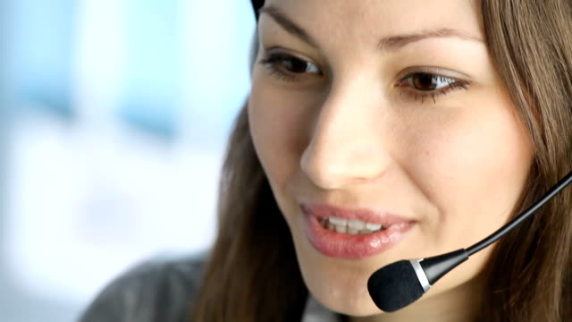 HD1080p30: Customer support phone operator smiling, tripod