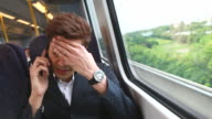 HD:Angry businessman using mobile phone during his trip.
