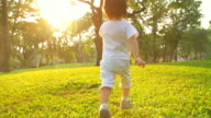 HD:Baby boy running at the park during sunset.
