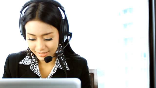 HD:Beautiful asian women operator smile.