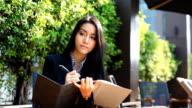 HD:Beautiful asian women taking note on notebook.