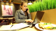 HD:Beautiful businesswoman working on her lunch inside at the coffee shop.
