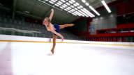 HD:Beautiful Female Having Figure Skating Performance
