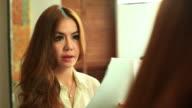 HD:Beautiful women preparing speech.