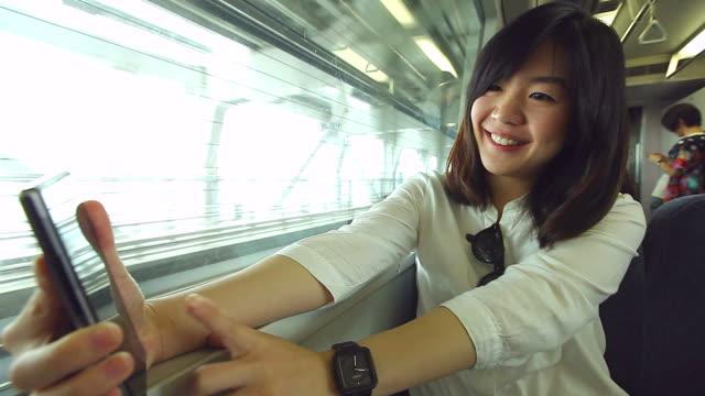 HD:Beauty asian women enjoy selfie on the train.