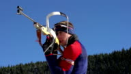 HD:Biathlon competitor shooting during competition