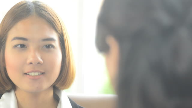 HD:Business asian woman talking with customer
