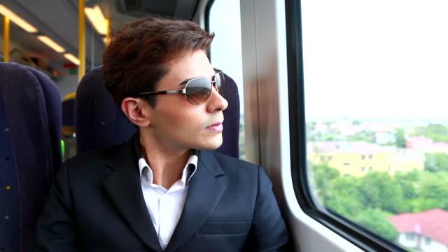HD:Businessman travel by train.