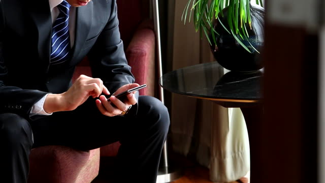 HD:Businessman working by using mobile phone.