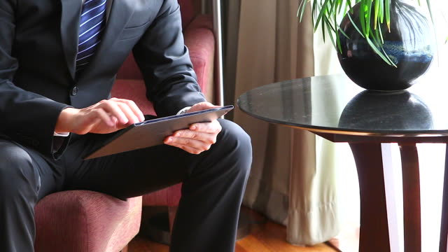 HD:Businessman working by using tablet.
