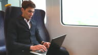 HD:Businessman working on the train with laptop.