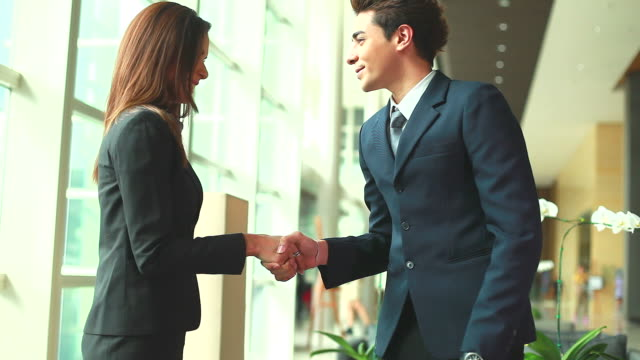 HD:Businesspeople greeting at Hotel lobby.