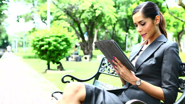 HD:Businesswoman working with tablet outdoor.