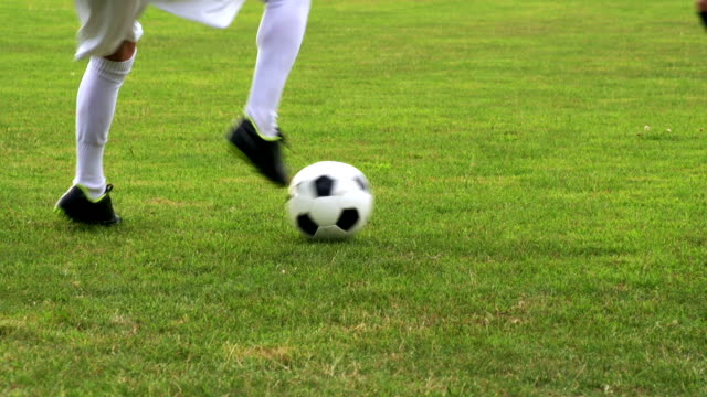 HD:Close-up of soccer dribbling