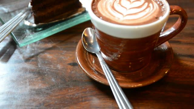 HD:Coffee art with chocolate cake