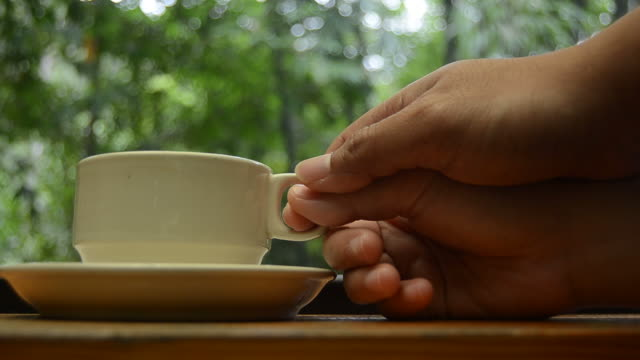 HD:Coffee in the nature with hand for relax time