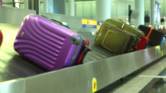 HD:Colorful baggage belt moving.