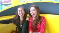 HD:Couple woman enjoy playing at amusement park.