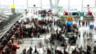 HD:Crowd people waiting in row to check-in at the Airport.